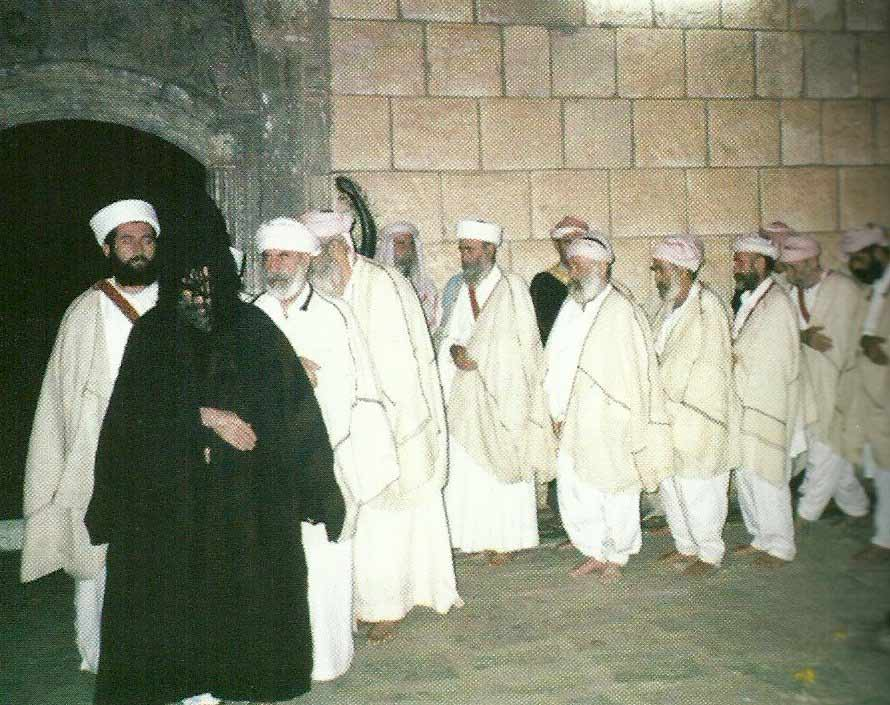 Fourteen dancers  dressed  in white, the color of purity...are led by the head of the Faqirs, who dresses in black